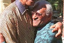 Nelson Mandela and Desmond Tuto embracing