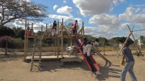 Rooibok community children on playground equipment